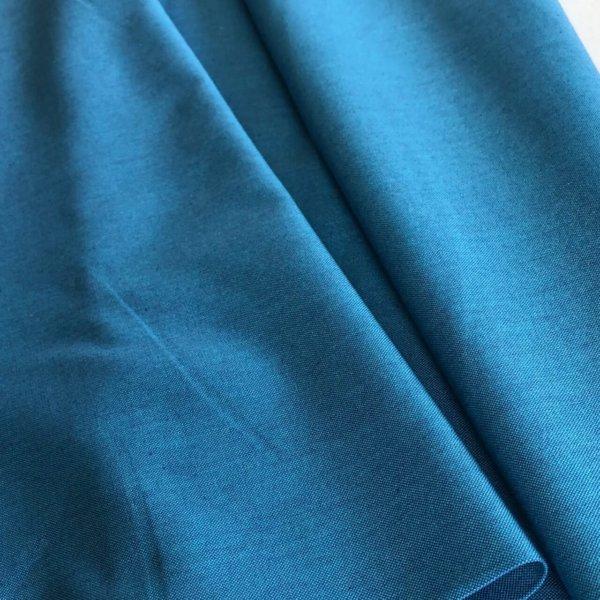 Lovely, medium blue solid fabric