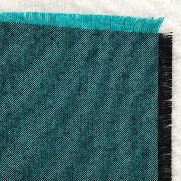 Peacock teal swatch showing bright turquoise warp and black weft