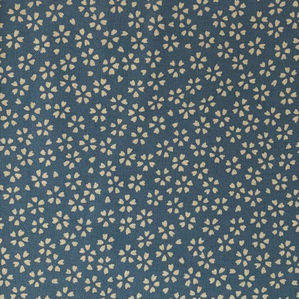 Light blue fabric, densely printed with traditional white cherry blossoms