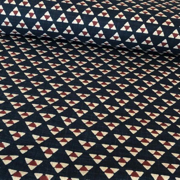 Repeated triangle motifs on indigo blue homespun fabric